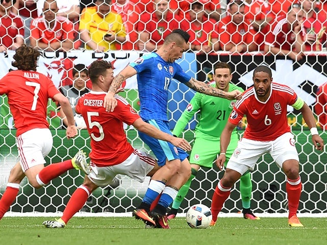 Marek Hamsik vies for the ball with James Chester and Ashley Williams during the Euro 2016 Group B match between Wales and Slovakia on June 11, 2016