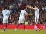 Mark Wright of England celebrates his goal with Olly Murs during the Soccer Aid 2016 match in aid of UNICEF at Old Trafford on June 5, 2016