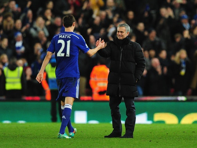 Chelsea player Nemanja Matic is congratulated by his manager Jose Mourinho on December 22, 2014