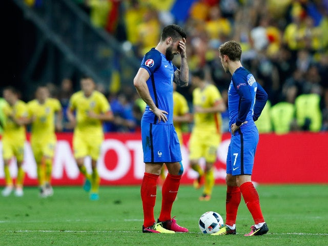 Olivier Giroud (L) and Antoine Griezmann (R) of France react after Romania's first goal during the UEFA Euro 2016 Group A match between France and Romania at Stade de France on June 10, 2016 in Paris, France
