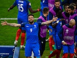 Olivier Giroud (1st L) of France celebrates scoring his team's first goal with his team mates during the UEFA Euro 2016 Group A match between France and Romania at Stade de France on June 10, 2016 in Paris, France