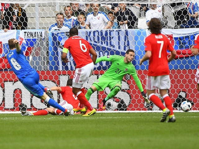 Slovakia's midfielder Ondrej Duda shoots and scores his team's first goal during the Euro 2016 Group B match against Wales on June 11, 2016