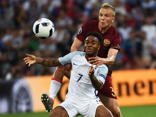 Raheem Sterling and Igor Smolnikov during the Euro 2016 Group B game between England and Russia on June 11, 2016