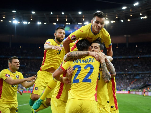 Bogdan Stancu (1st R) of Romania celebrates scoring his team's first goal with his team mates during the UEFA Euro 2016 Group A match between France and Romania at Stade de France on June 10, 2016 in Paris, France