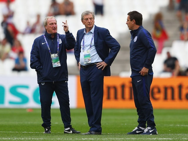 England manager Roy Hodgson speaks with his assistant coaches Ray Lewington and Gary Neville prior to kickoff against Russia on June 11, 2016