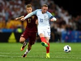 Wayne Rooney and Oleg Shatov compete for the ball during the Euro 2016 Group B game between England and Russia on June 11, 2016