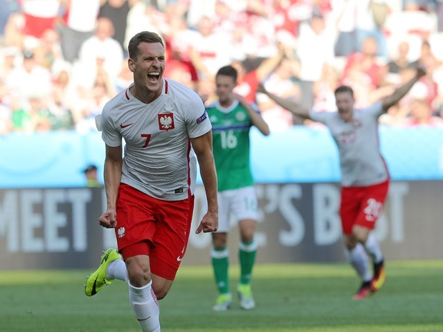 Poland's forward Arkadiusz Milik celebrates his goal during the Euro 2016 Group C match against Northern Ireland on June 12, 2016