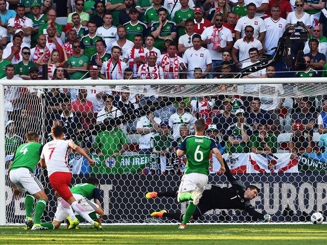 Arkadiusz Milik scores during the Euro 2016 Group C game between Poland and Northern Ireland on June 12, 2016