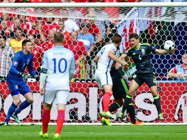 Ben Davies is hit in the arm by the ball during the Euro 2016 Group B game between England and Wales on June 16, 2016