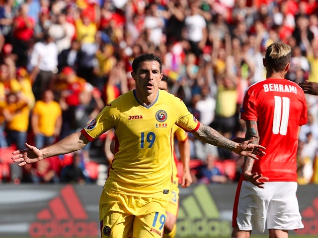 Bogdan Stancu celebrates scoring a penalty during the Euro 2016 Group A game between Romania and Switzerland on June 15, 2016