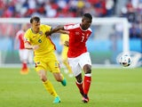 Breel Embolo and Vlad Chiriches in action during the Euro 2016 Group A game between Romania and Switzerland on June 15, 2016
