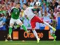 Chris Baird and Arkadiusz Milik during the Euro 2016 Group C game between Poland and Northern Ireland on June 12, 2016