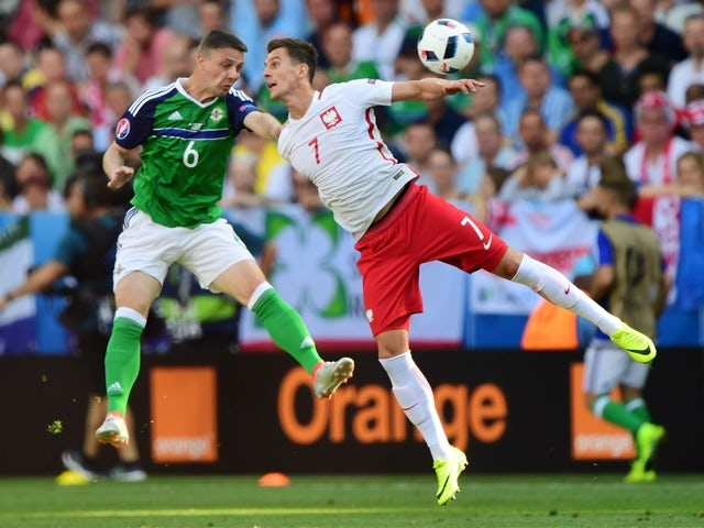 Chris Baird and Arkadiusz Milik during the Euro 2016 Group C game between Poland and Northern Ireland on June 12, 2016