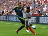 Chris Gunter and Raheem Sterling during the Euro 2016 Group B game between England and Wales on June 16, 2016