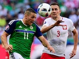 Northern Ireland's Conor Washington vies with Poland's Artur Jedrzejczyk during the Euro 2016 Group C match on June 12, 2016