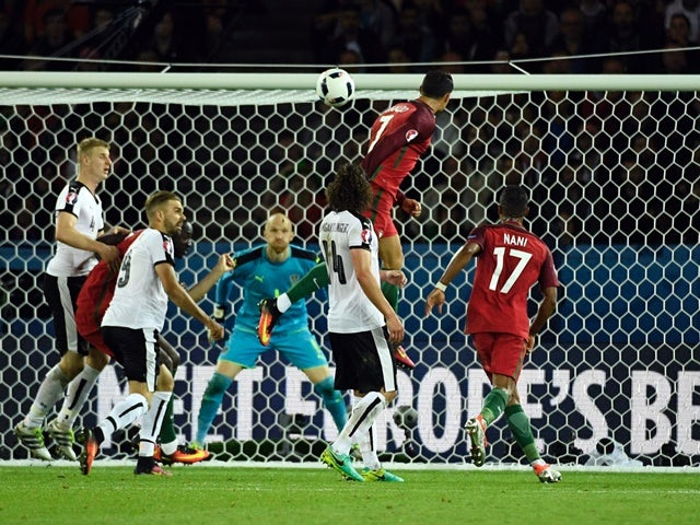 Cristiano Ronaldo heads the ball towards goal during the Euro 2016 Group F match between Portugal and Austria on July 18, 2016