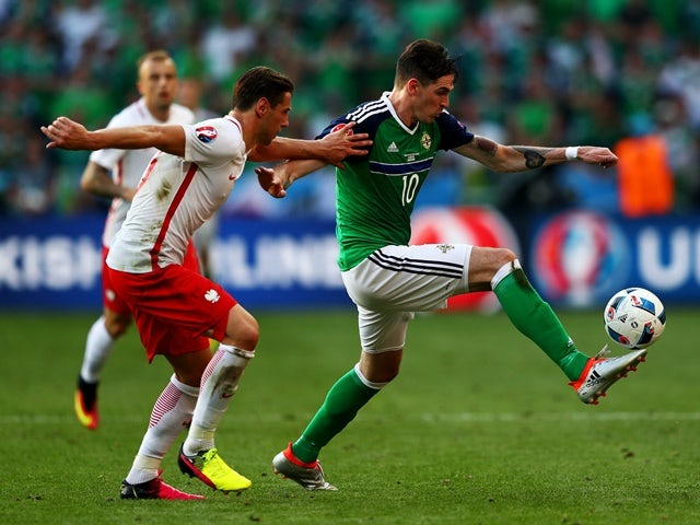 Grzegorz Krychowiak and Kyle Lafferty in action during the Euro 2016 Group C game between Poland and Northern Ireland on June 12, 2016
