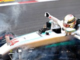 Lewis Hamilton stops on circuit during qualifying for the European Formula One Grand Prix at Baku City Circuit on June 18, 2016