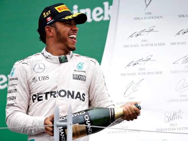 Lewis Hamilton of Mercedes celebrates his win on the podium during the Canadian Formula One Grand Prix at Circuit Gilles Villeneuve on June 12, 2016