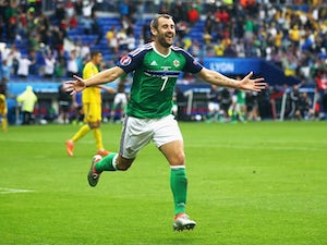 Northern Ireland keep hopes alive with win
