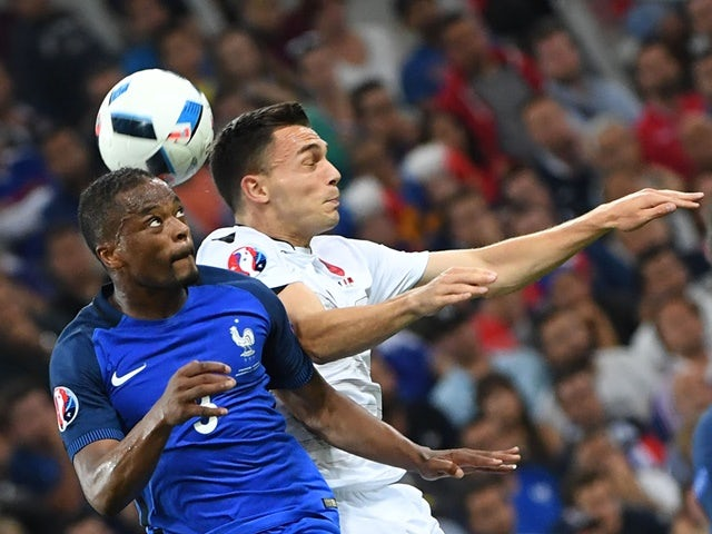 Patrice Evra and Taulant Xhaka in action during the Euro 2016 Group A game between France and Albania on June 15, 2016