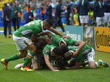 Ireland's midfielder Wesley Hoolahan (C, bottom) celebrates with teammates after scoring a goal during the Euro 2016 Group E football match between Ireland and Sweden at the Stade de France stadium in Saint-Denis on June 13, 2016