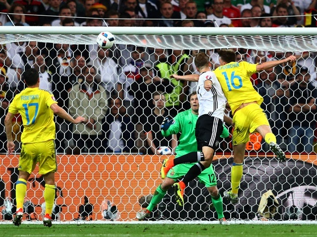 Shkodran Mustafi of Germany heads the ball to score his team's first goal against Ukraine at Stade Pierre-Mauroy on June 12, 2016