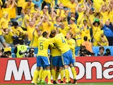 Sweden's players celebrate after Ireland scored an own goal during the Euro 2016 group E football match between Ireland and Sweden at the Stade de France stadium in Saint-Denis on June 13, 2016