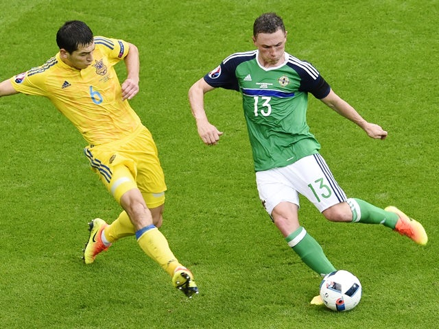 Taras Stepanenko and Corry Evans during the Euro 2016 Group C match between Ukraine and Northern Ireland on July 16, 2016