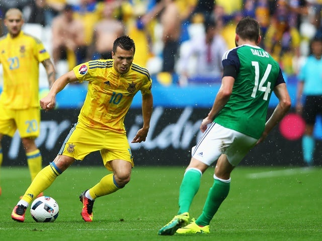 Yevhen Konoplyanka and Stuart Dallas in action during the Euro 2016 Group C match between Ukraine and Northern Ireland on July 16, 2016