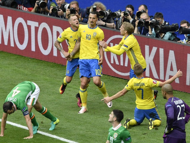 Sweden's forward Zlatan Ibrahimovic (C) celebrates with teammates after Ireland scored an own goal during the Euro 2016 group E football match between Ireland and Sweden at the Stade de France stadium in Saint-Denis on June 13, 2016