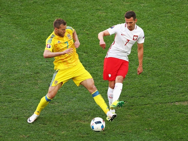 Andriy Yarmolenko and Arkadiusz Milik in action during the Euro 2016 Group C match between Ukraine and Poland on June 21, 2016