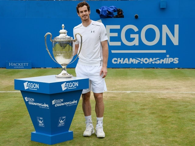 Andy Murray with the trophy after victory in the final against Milos Raonic at Queen's on June 19, 2016