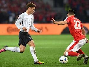 Switzerland through with France draw