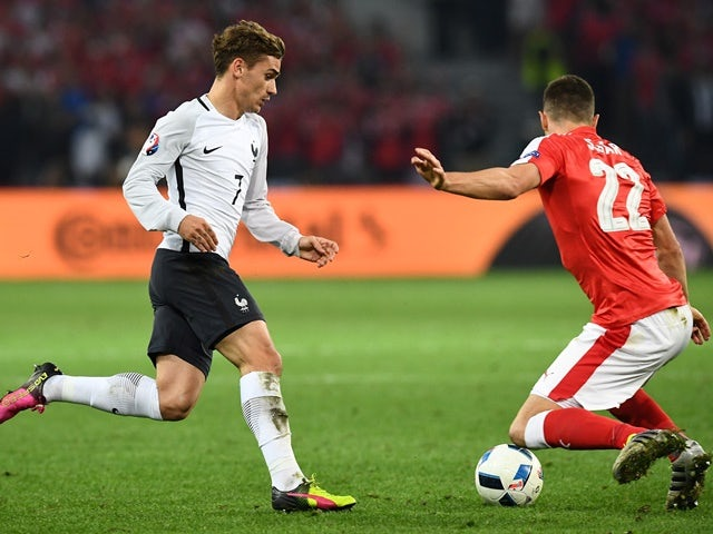 Antoine Griezmann and Fabian Schaer in action during the Euro 2016 Group A match between Switzerland and France on June 19, 2016