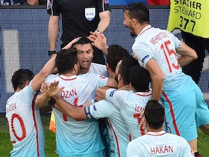 Turkey keep last-16 hopes alive with win