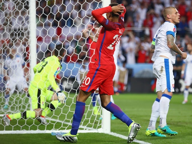 Dele Alli reacts after missing a chance during the Euro 2016 Group B match between Slovakia and England on June 20, 2016