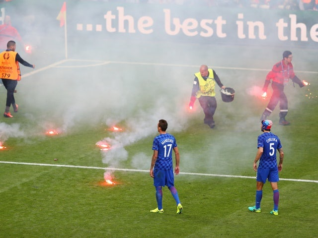 Flares on the pitch during the Euro 2016 Group D match between Czech Republic and Croatia on June 17, 2016