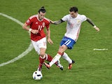 Gareth Bale and Pavel Mamaev in action during the Euro 2016 Group B match between Russia and Wales on June 20, 2016