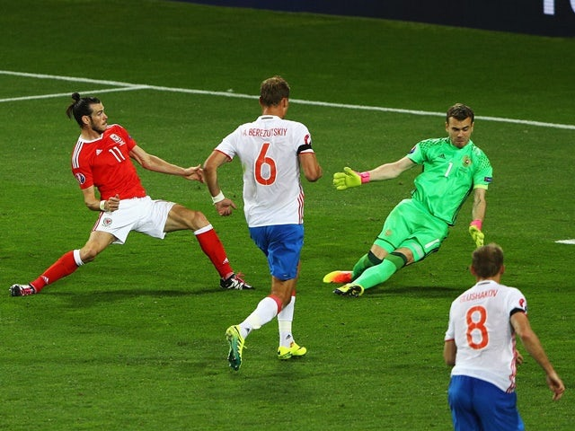 Gareth Bale scores his side's third goal during the Euro 2016 Group B match between Russia and Wales on June 20, 2016