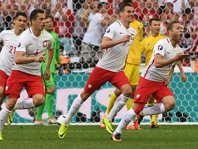 Jakub Blaszczykowski celebrates scoring during the Euro 2016 Group C match between Ukraine and Poland on June 21, 2016