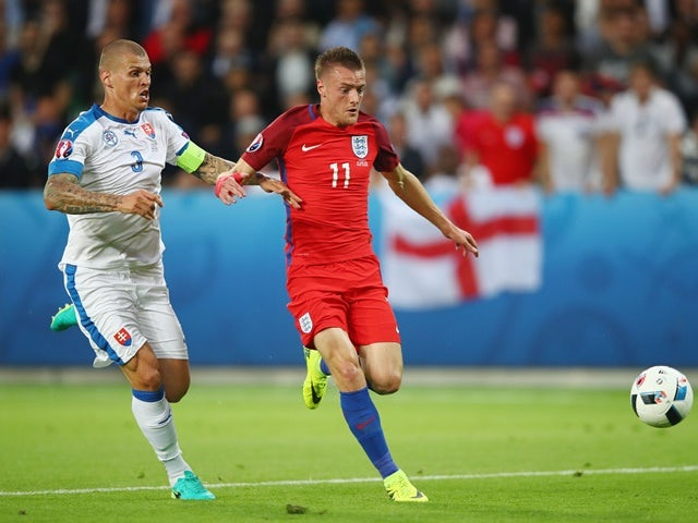 Jamie Vardy and Martin Skrtel in action during the Euro 2016 Group B match between Slovakia and England on June 20, 2016