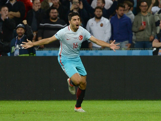 Ozan Tufan celebrates after scoring a goal during the Euro 2016 Group D match between Czech Republic and Turkey on June 21, 2016