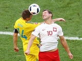 Ruslan Rotan and Grzegorz Krychowiak in action during the Euro 2016 Group C match between Ukraine and Poland on June 21, 2016