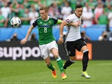 Steven Davis and Mesut Ozil in action during the Euro 2016 Group C match between Northern Ireland and Germany on June 21, 2016