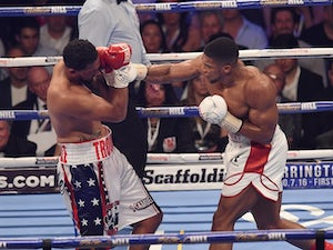 Joshua stops Breazeale to defend world title