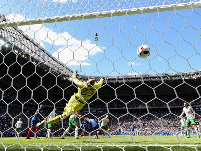 Darren Randolph dives in vain as Antoine Griezmann scores his second goal during the Euro 2016 RO16 match between France and Republic of Ireland on June 26, 2016