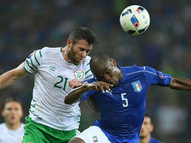 Daryl Murphy and Angelo Ogbonna  in action during the Euro 2016 Group E match between Italy and Republic of Ireland  on June 22, 2016