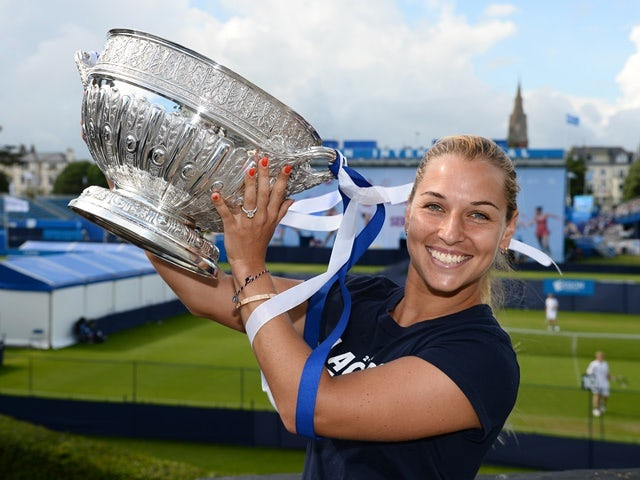 Dominika Cibulkova of Slovakia with trophy after victory in the final match against Karolina Pliskova of the Czech Republic on day 7 at Devonshire Park on June 25, 2016