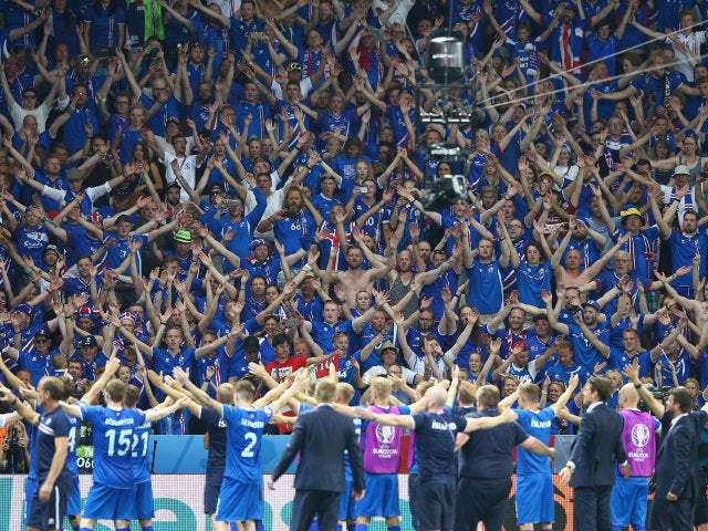Iceland supporters celebrate their team's 2-1 win after the UEFA EURO 2016 round of 16 match between England and Iceland at Allianz Riviera Stadium on June 27, 2016 in Nice, France